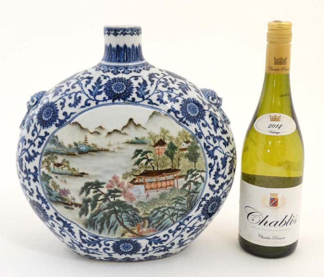 A Chinese blue and white moon flask having panels