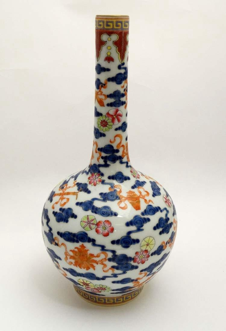 A pair of Chinese blue and white bottle vases decorated - 4