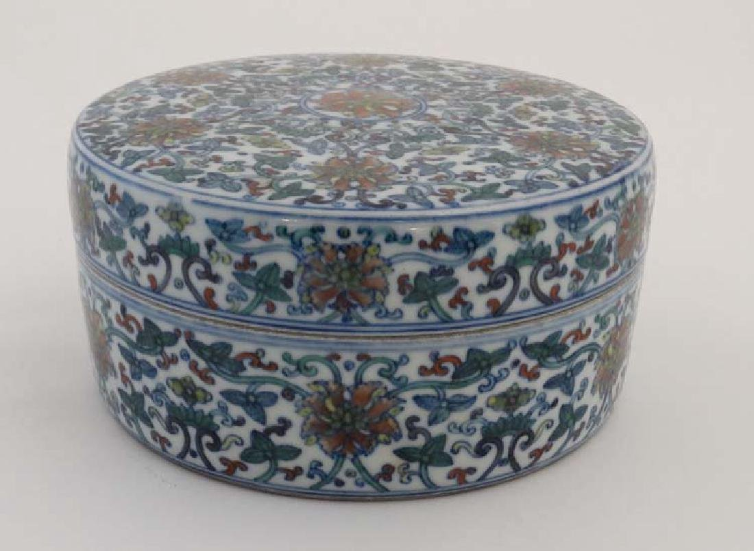 A Chinese circular lidded pot. Hand painted with floral - 4