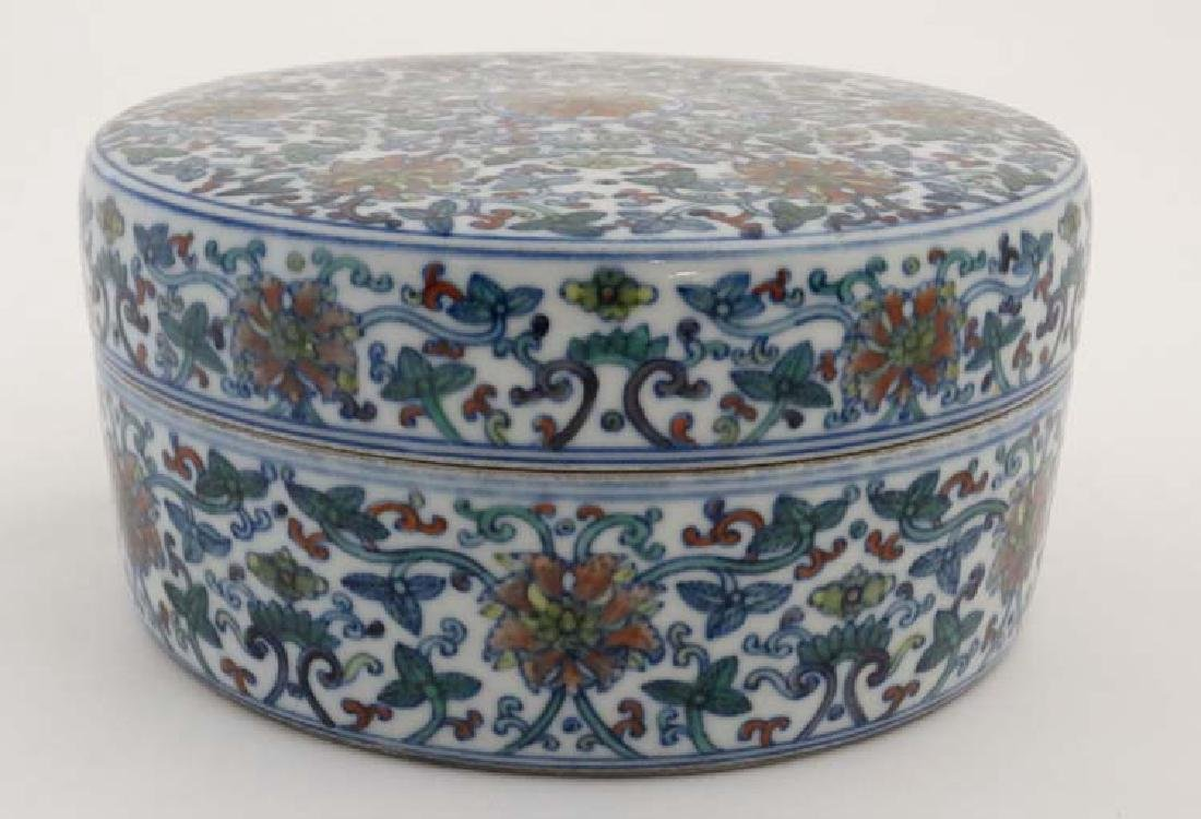 A Chinese circular lidded pot. Hand painted with floral - 5