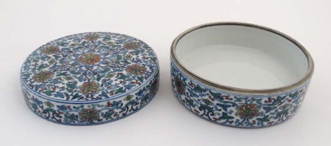A Chinese circular lidded pot. Hand painted with floral - 6