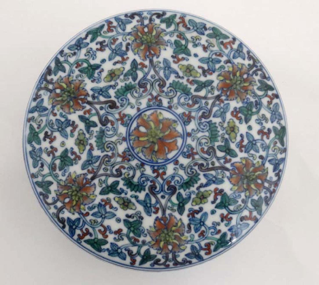 A Chinese circular lidded pot. Hand painted with floral - 7
