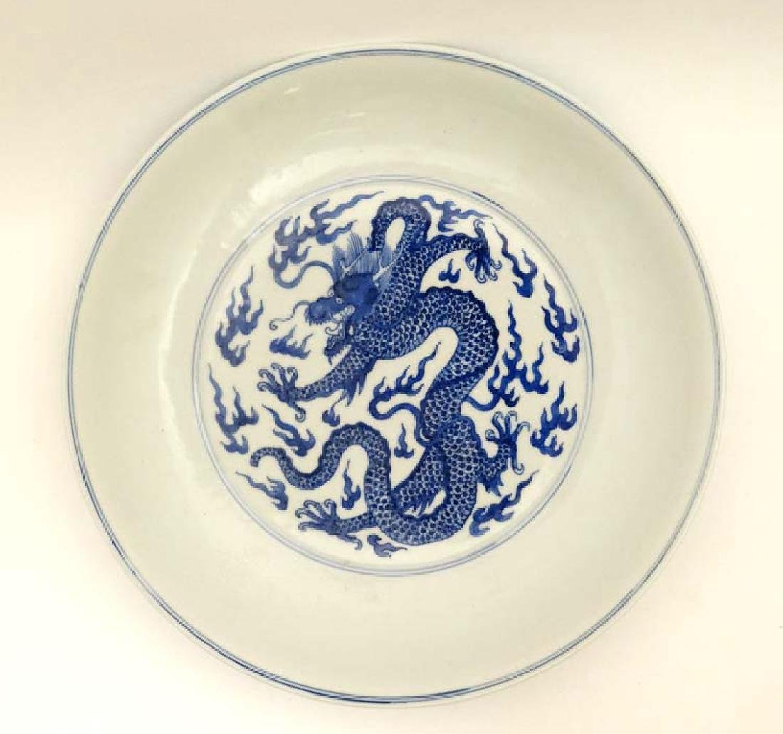 A Chinese blue and white ' Dragon ' dish , the central
