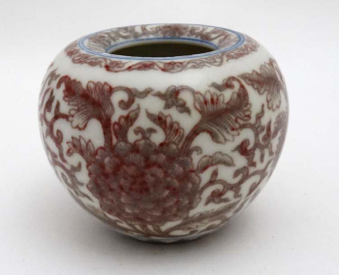 A Chinese copper red and white vase of squat form ,