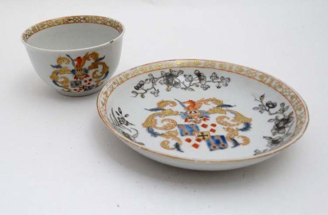 A Chinese Export famille rose  armorial tea bowl and - 3