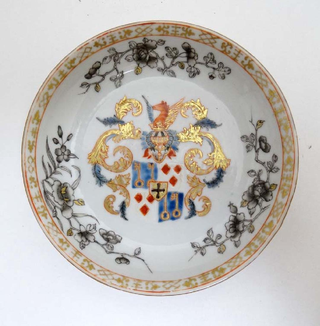 A Chinese Export famille rose  armorial tea bowl and - 4