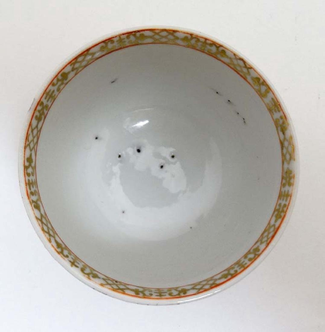 A Chinese Export famille rose  armorial tea bowl and - 5