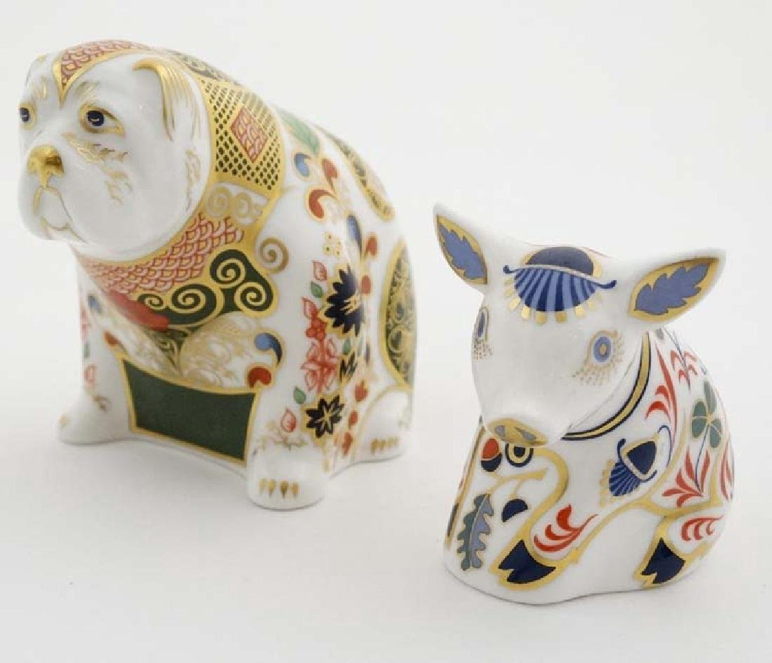 Two Royal Crown Derby paperweights. One formed as a Pig
