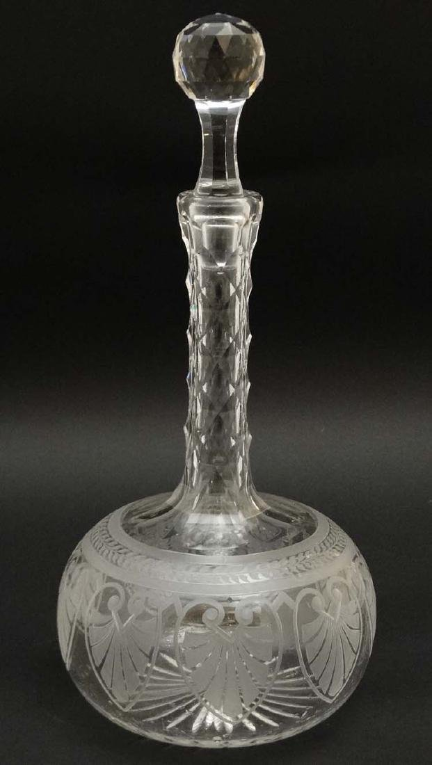 A 19thC glass decanter with facet cut decoration to the