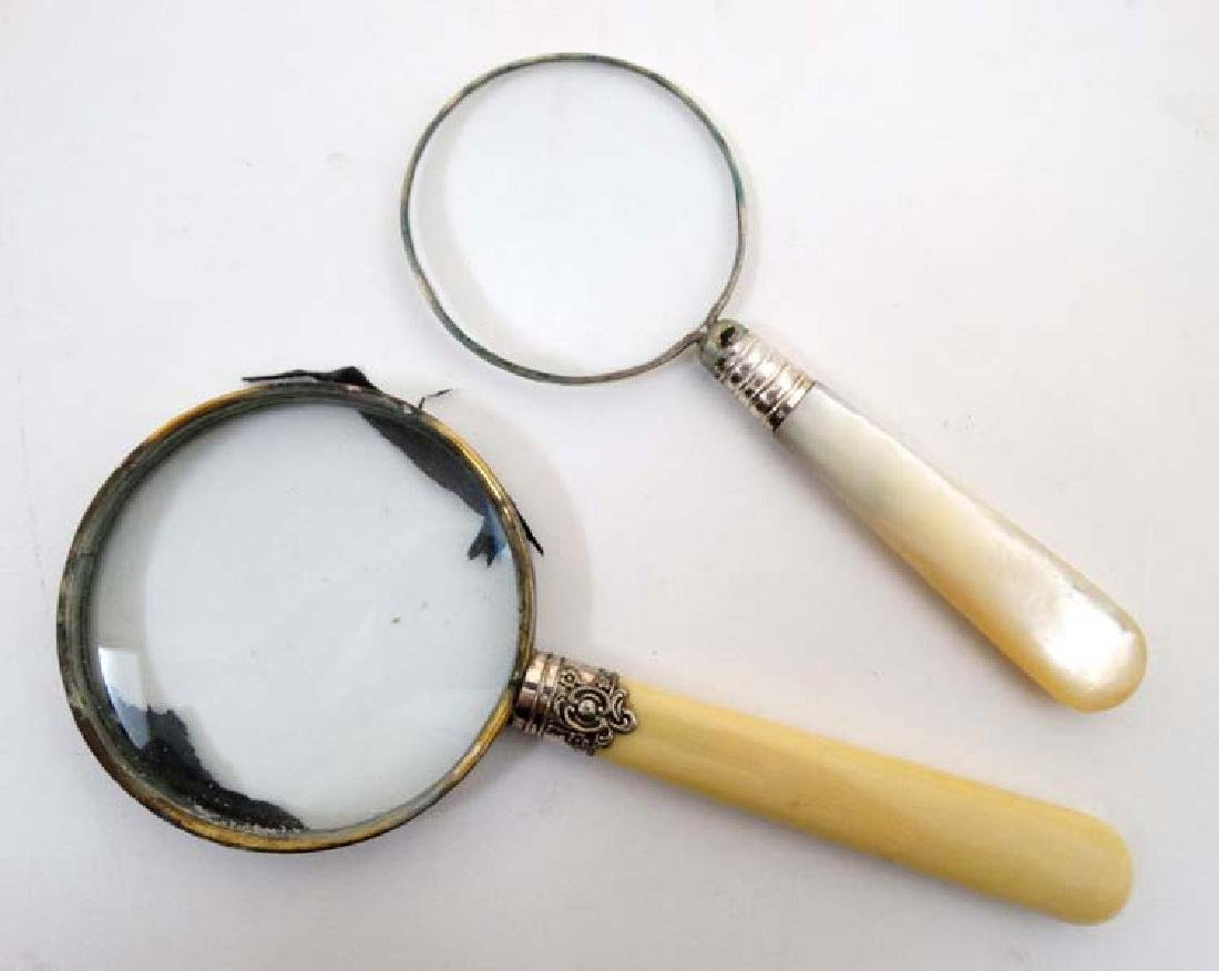 Two magnifying glasses. The largest 2 1/2'' diameter - 2
