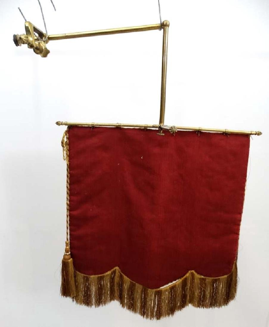 A Victorian brass hinged banner screen with crewelwork - 2