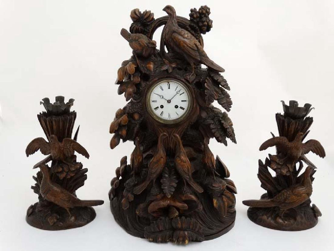 Impressive 19thC Black Forest clock and garnitures :