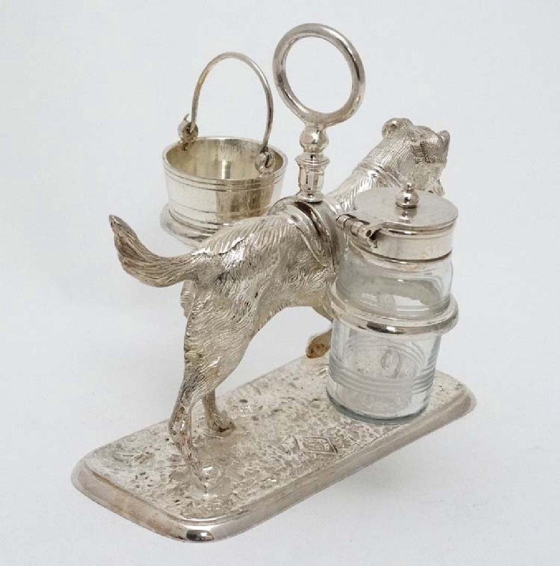 A 21stC novelty silver plate cruet stand formed as a - 5