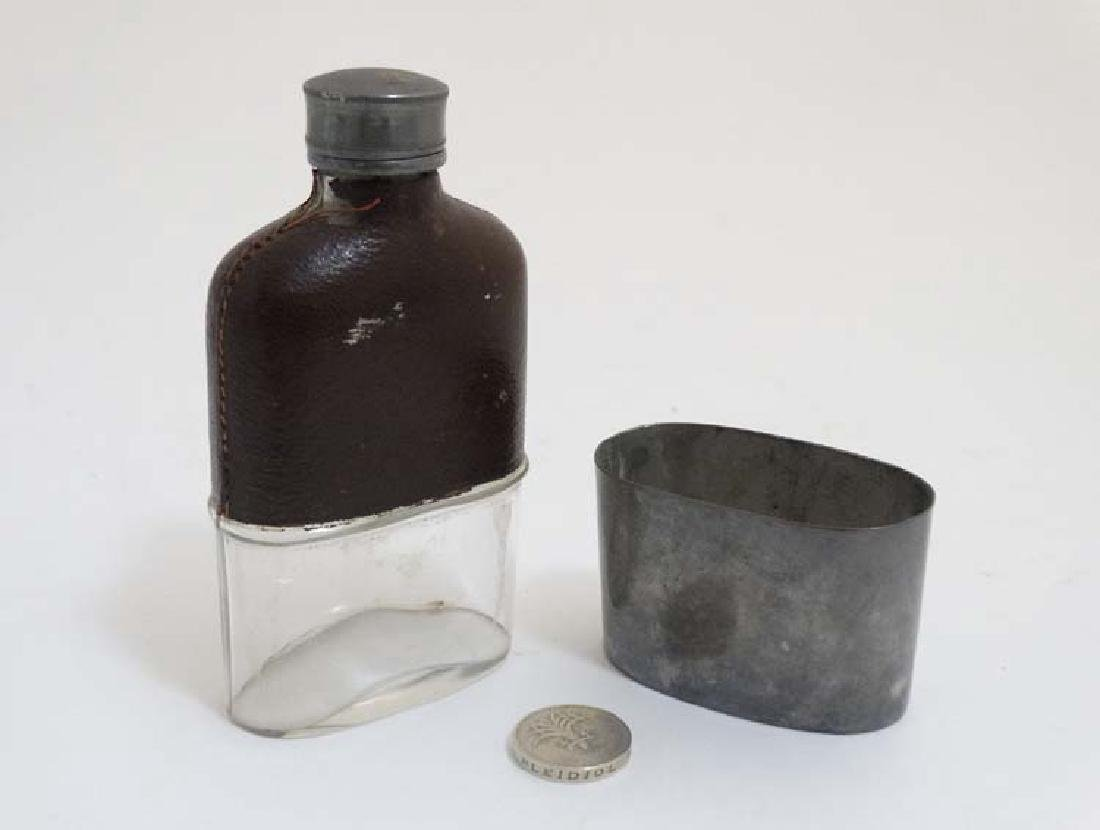 A hip flask with half leather covering and beaker to - 2