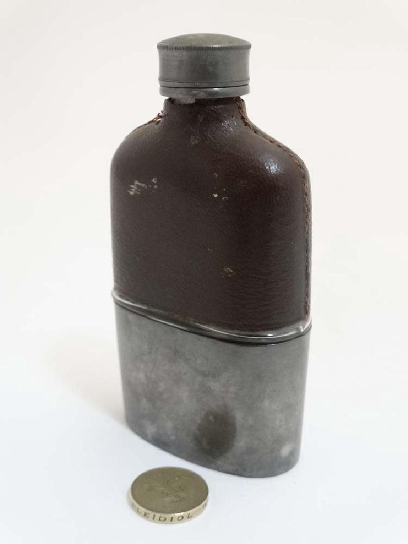 A hip flask with half leather covering and beaker to - 6