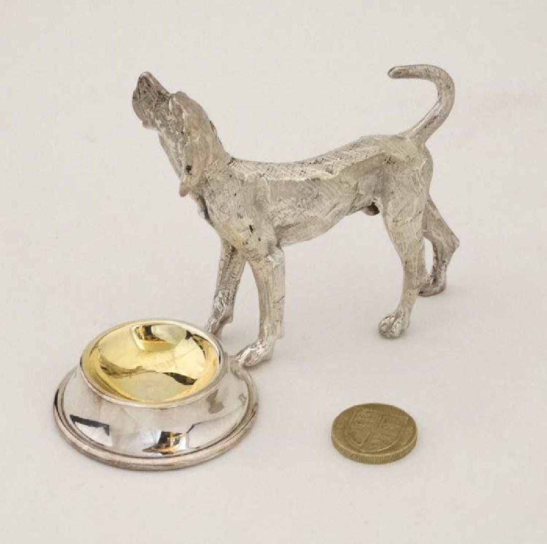 A silver plate novelty table salt formed as a dog