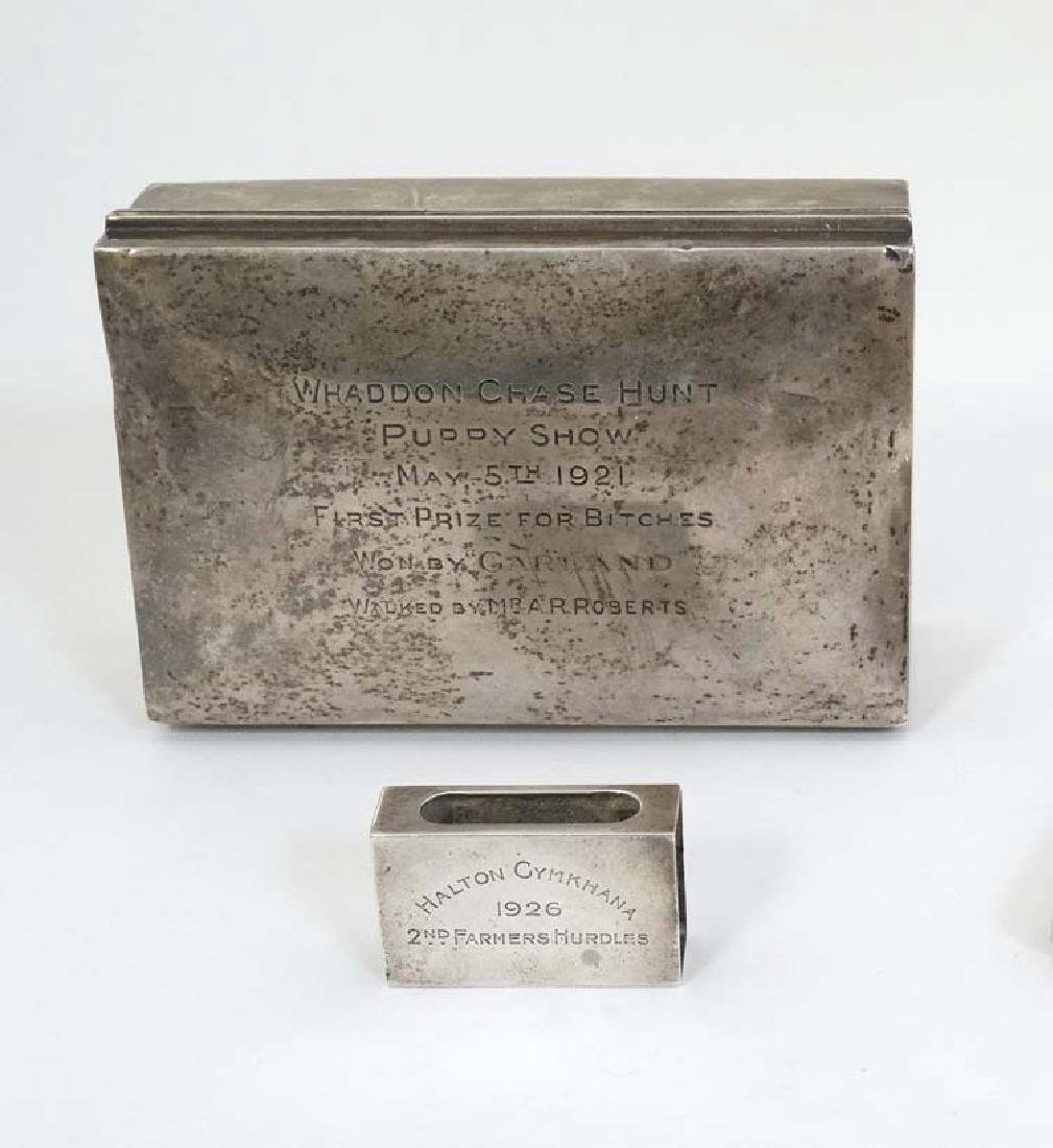A silver table top cigarette box engraved ' Whaddon