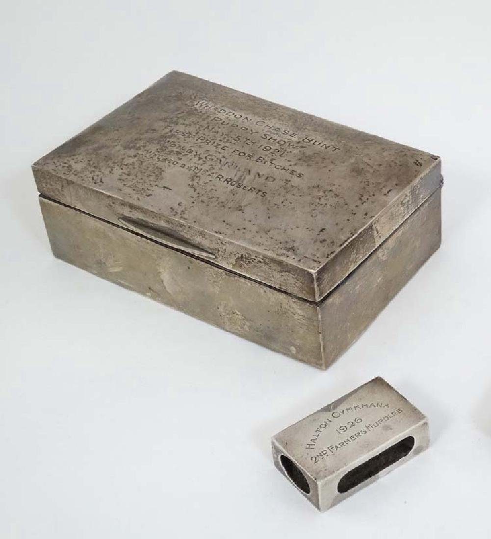 A silver table top cigarette box engraved ' Whaddon - 3