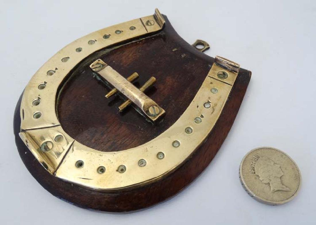 A small brass cribbage board formed as a horseshoe, - 4