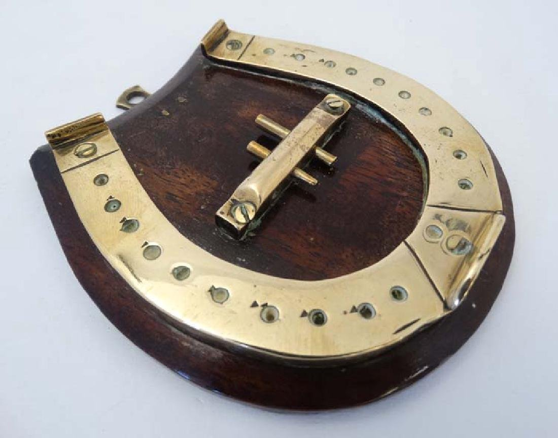 A small brass cribbage board formed as a horseshoe, - 5