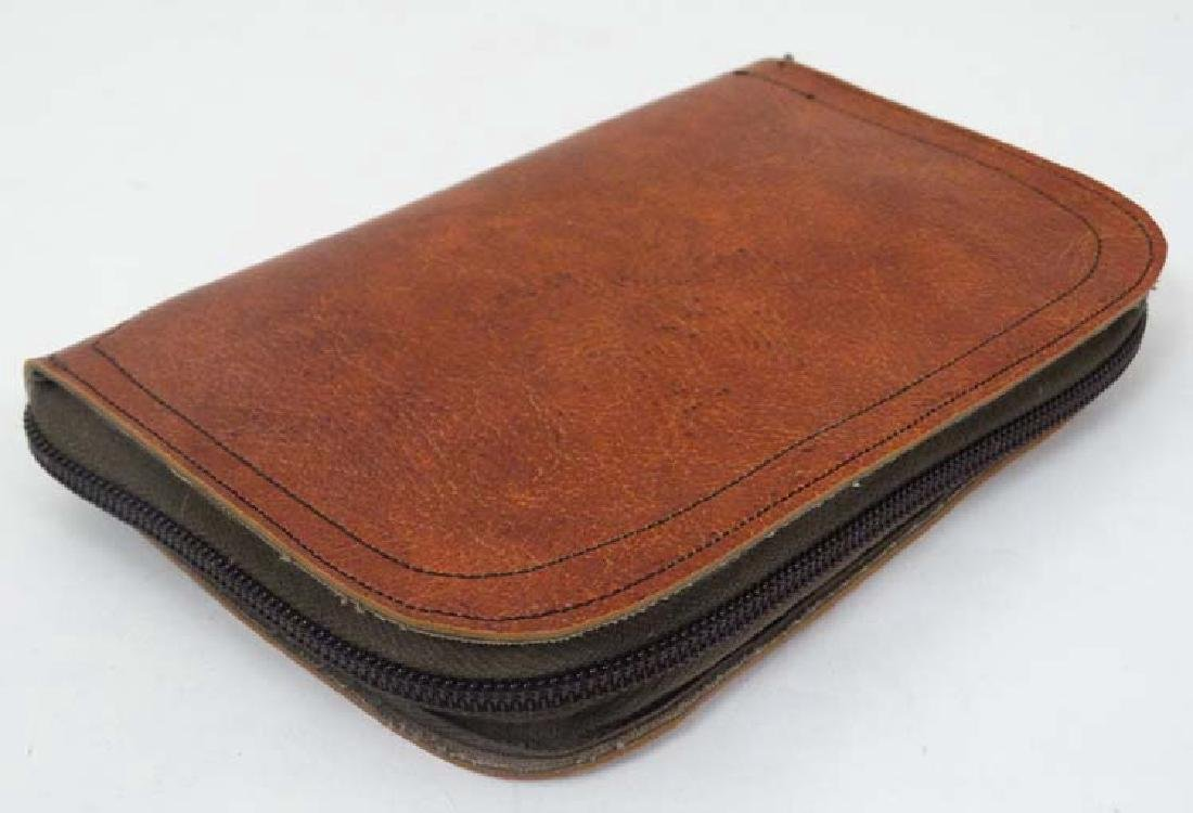 Fly - fishing :  A zip fastening fly wallet , unzipping - 3