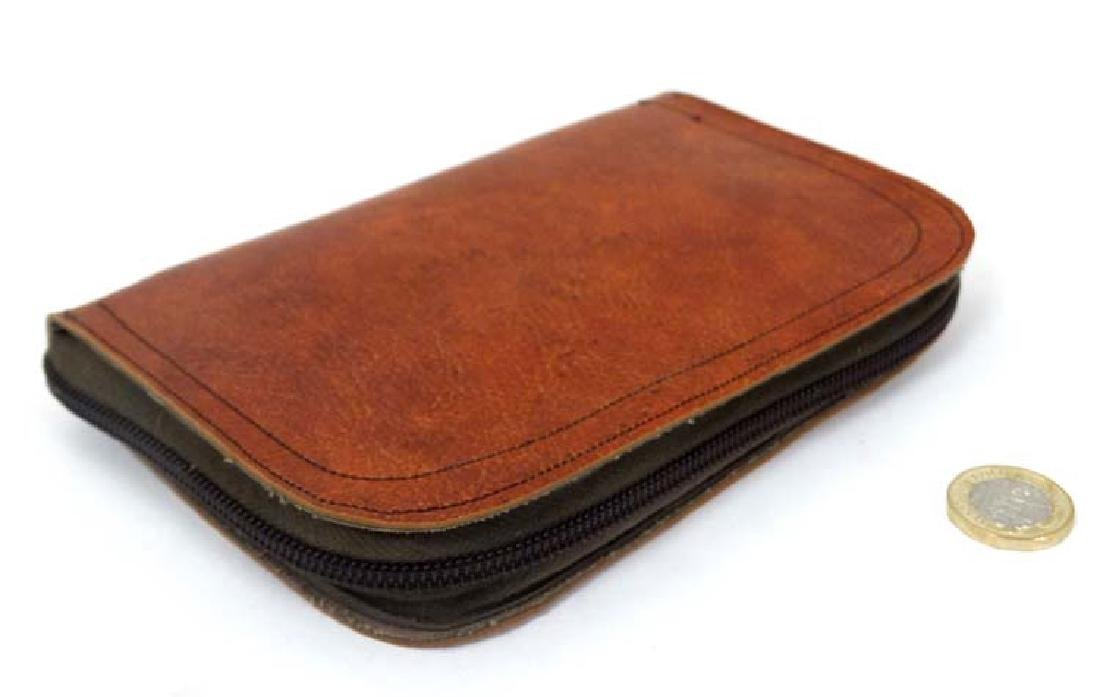 Fly - fishing :  A zip fastening fly wallet , unzipping - 4