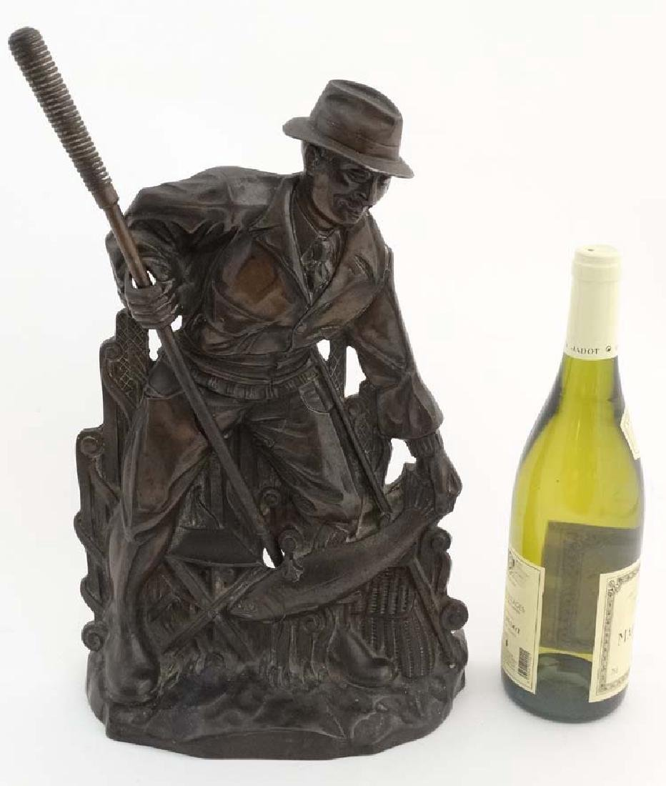 Fishing: A cast bronze relief fireside poker in the