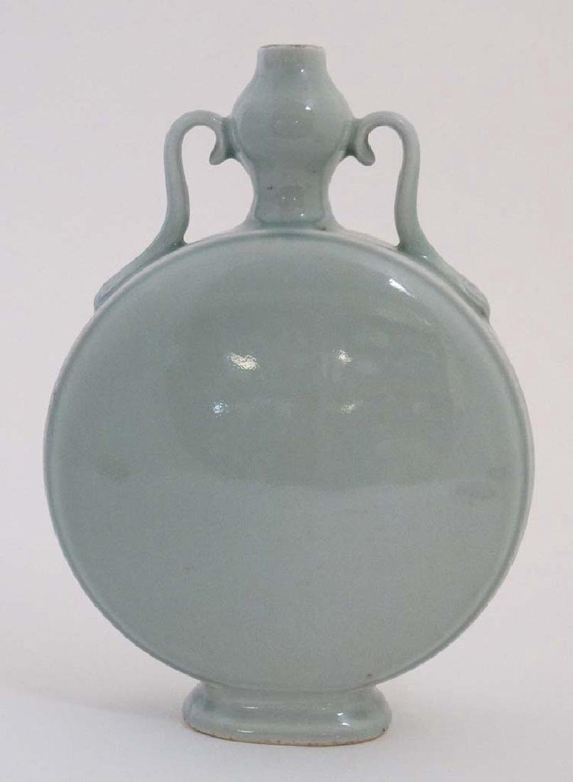 A Chinese Celadon twin handled Moon flask with unusual