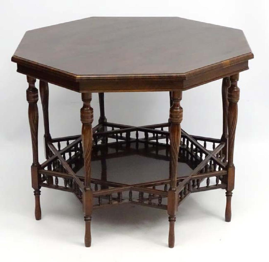A fine Aesthetic movement rosewood two tier octagonal