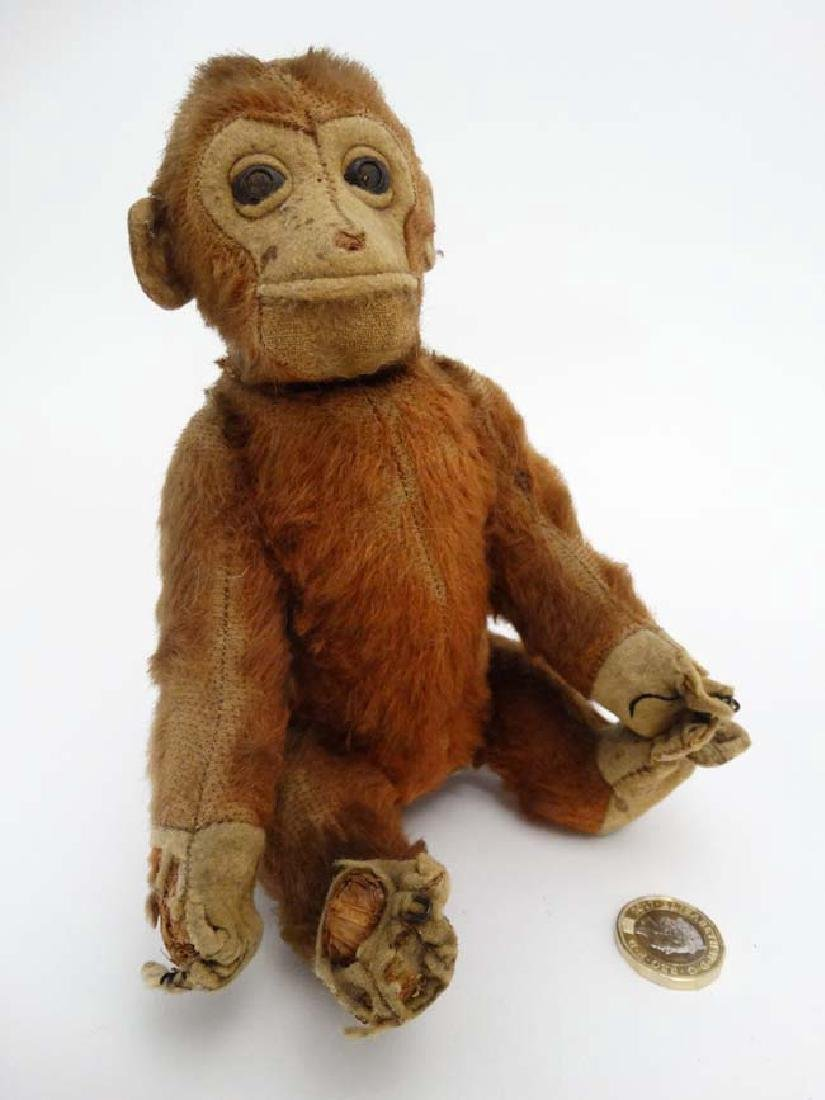 A c1930s possibly Schuco Yes/No brown mohair monkey