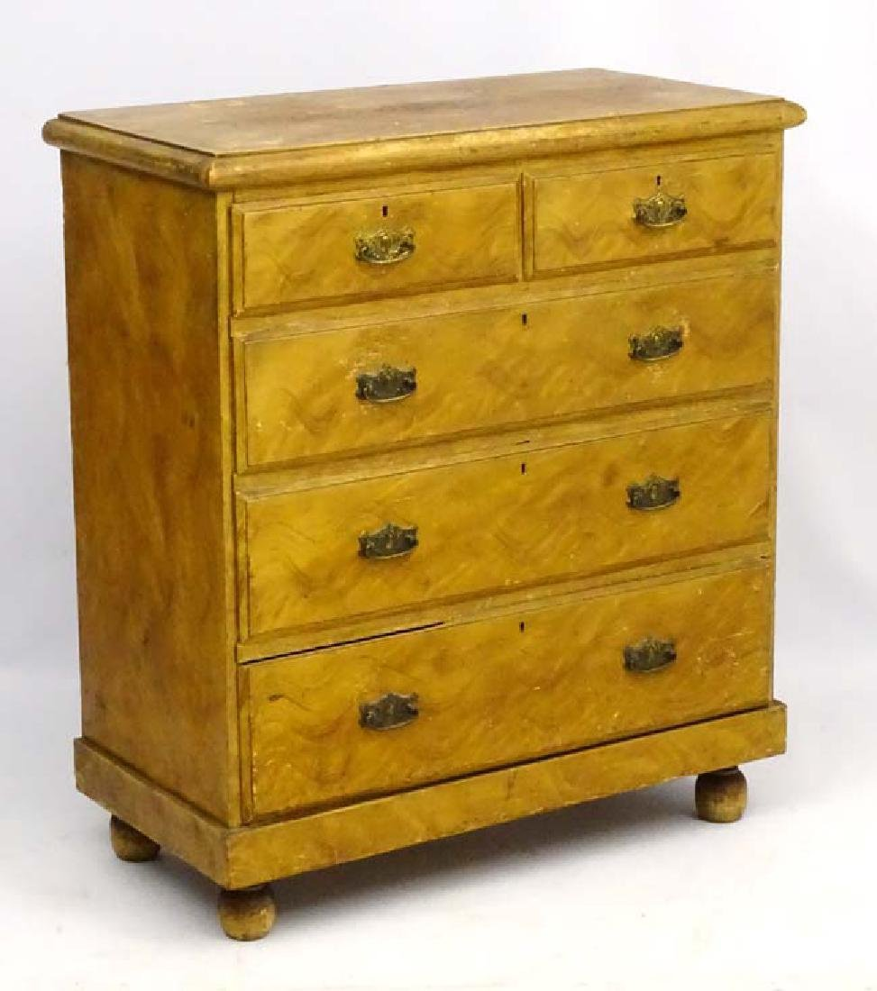 A Victorian Pine Chest Of Drawers Comprising Two Short