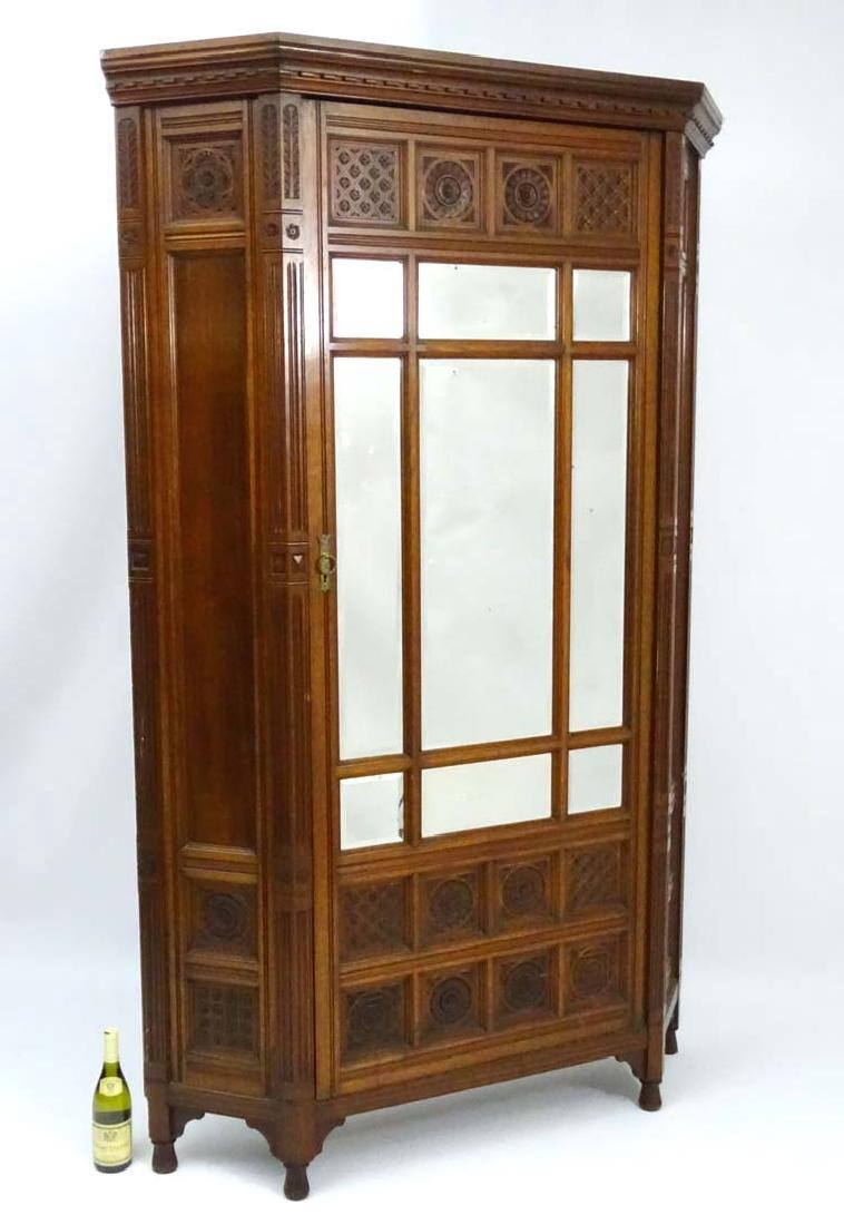 An Arts and Crafts walnut Vestment Cupboard / Hall