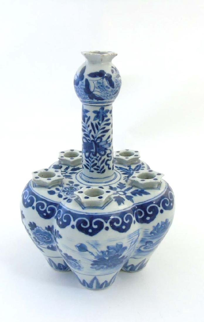 A Chinese blue and white tulip vase, depicting a pond