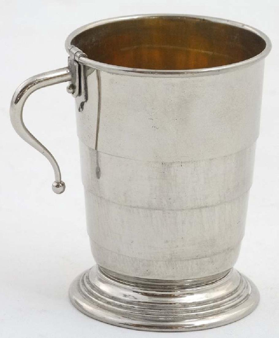 A silver plate expandable / travelling cup with gilded