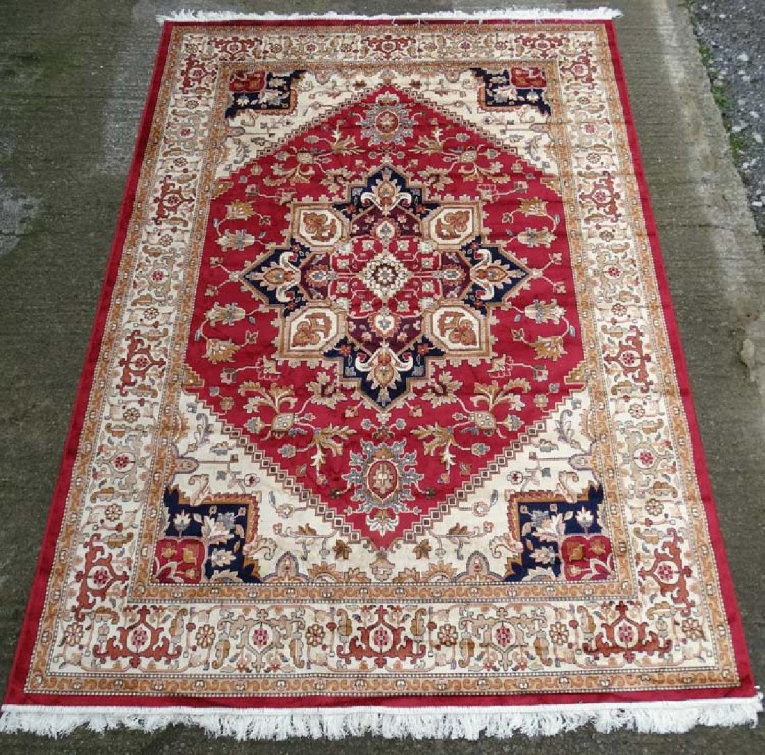 Carpet / Rug : A machine made woollen rug with red and