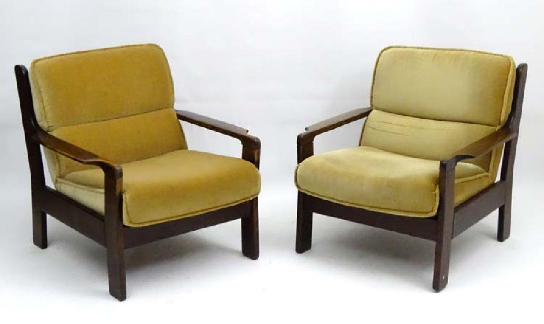 Vintage Retro: A pair of Danish open arm lounge chairs,