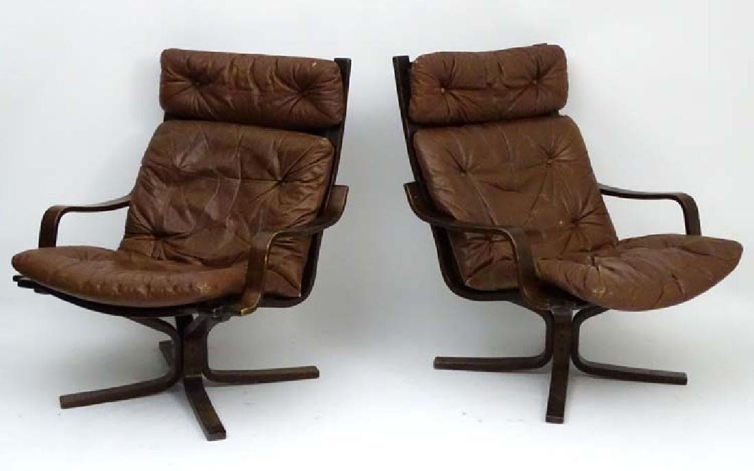 Vintage Retro : a pair of Danish brown leather open arm