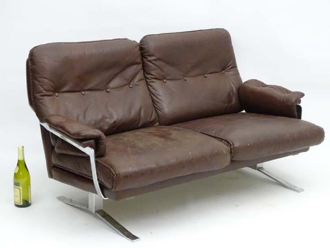 Vintage Retro: A Danish chrome and brown leather 2 seat