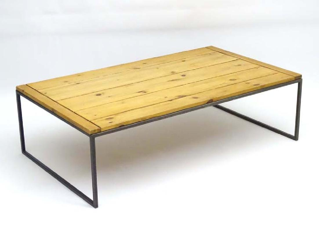 A Jim Lawrence coffee table, having an iron frame and