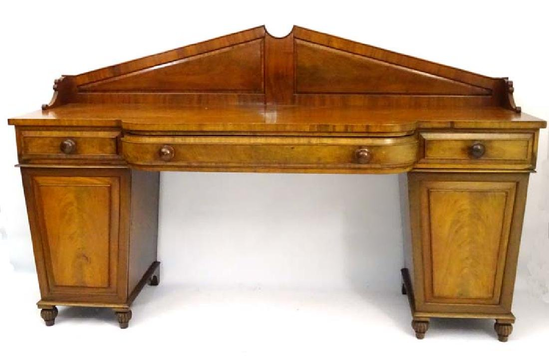 A William IV mahogany breakfront sideboard with raised