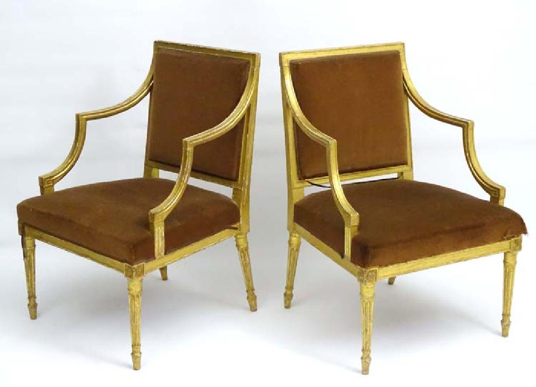 A pair of late 18thC Neoclassical gilt open armchairs