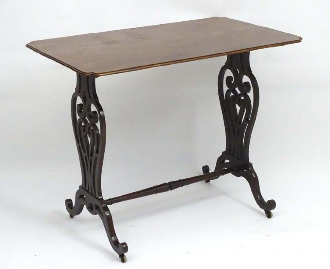 A 19thC mahogany Chippendale style table with carved