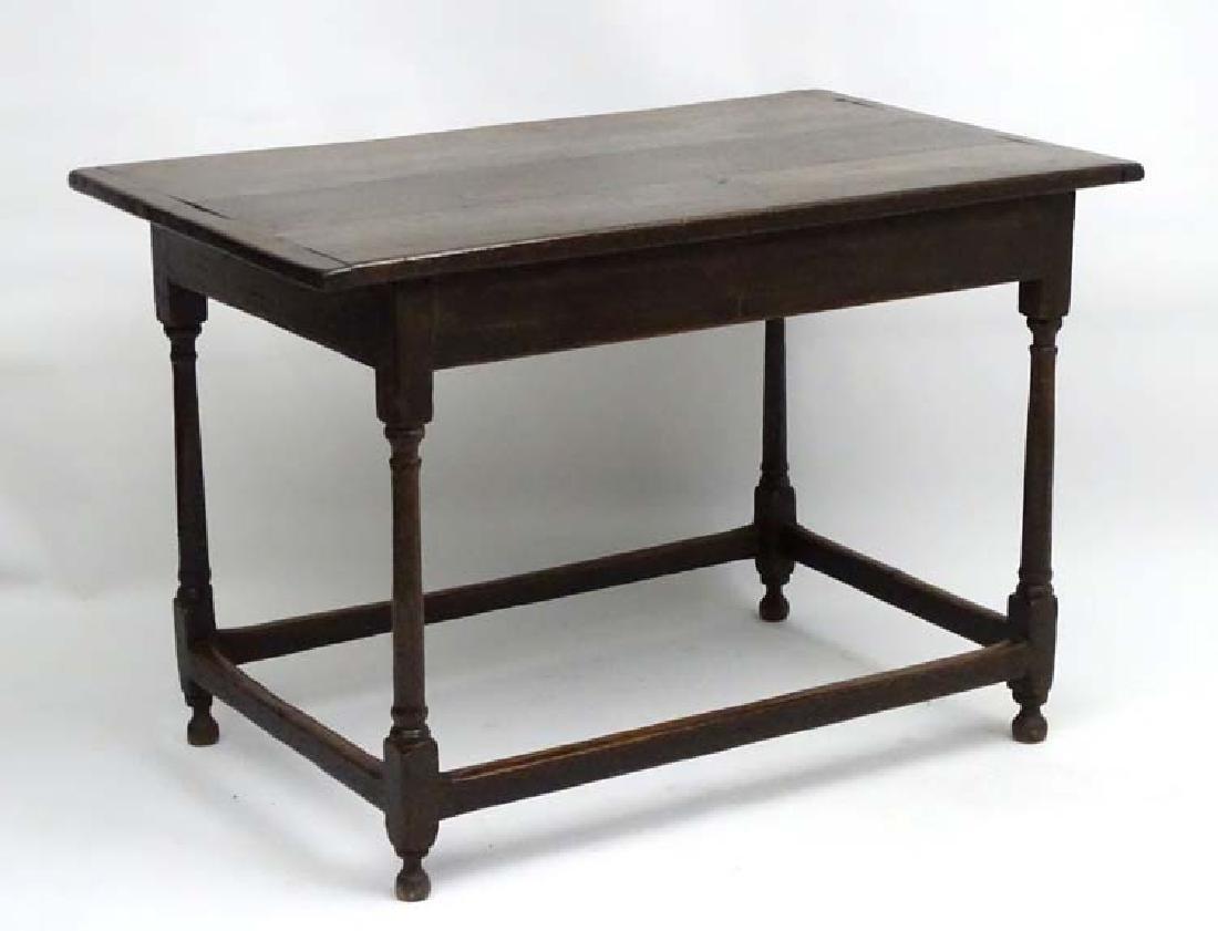 An 18thC oak centre table of rectangular form, pine peg