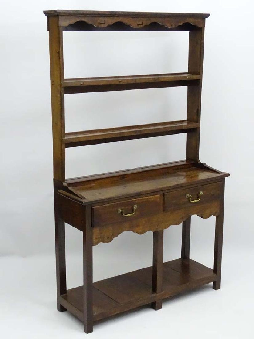 An early 20thC oak Dresser of small proportions with