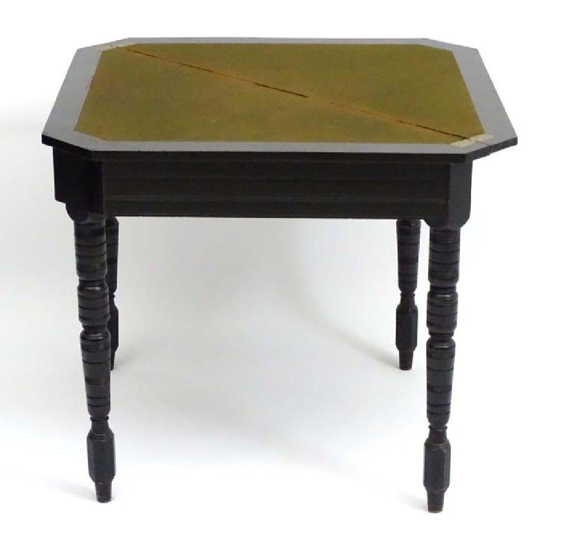 A Victorian ebony Card Table of Credence shape standing