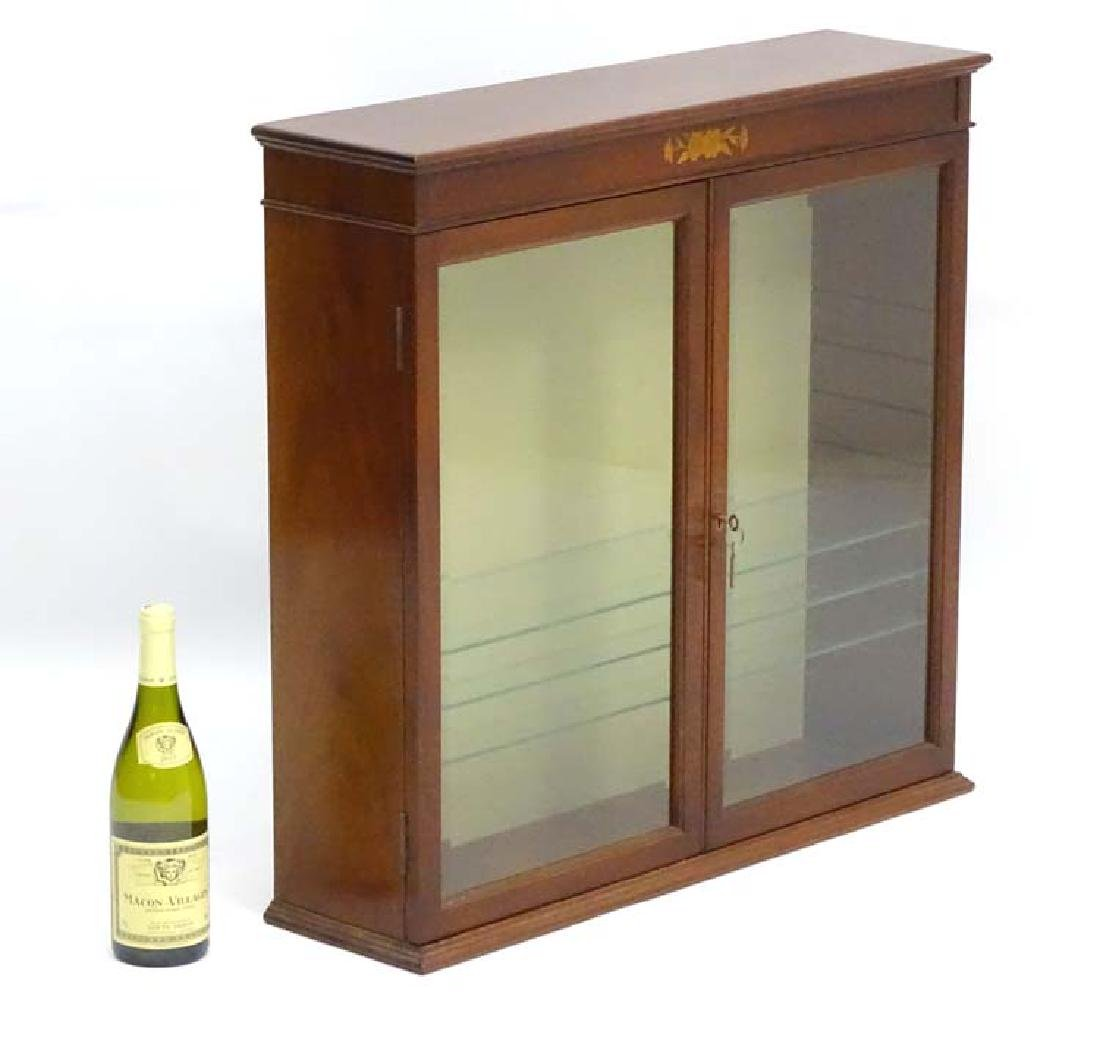 An early 20thC Sheraton Revival glazed cabinet, with