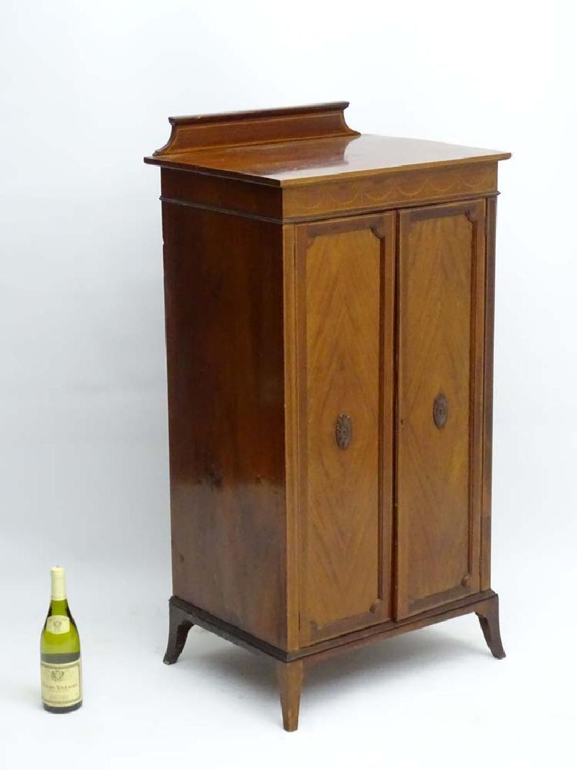 An early 20thC mahogany Sheraton Revival cabinet with
