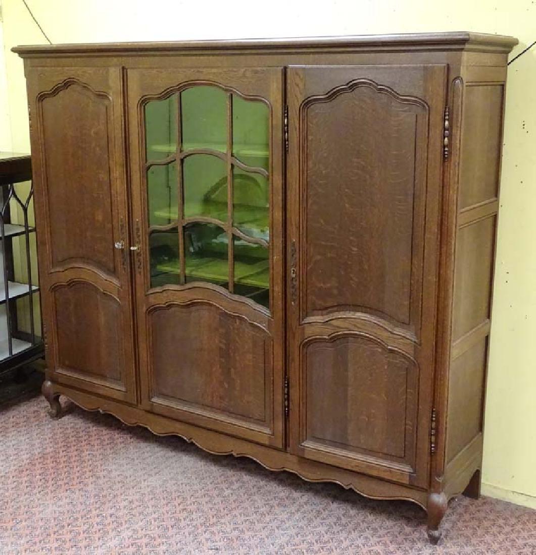 A c.1900 Louis XV style oak 3 sectional vitrine. 79''