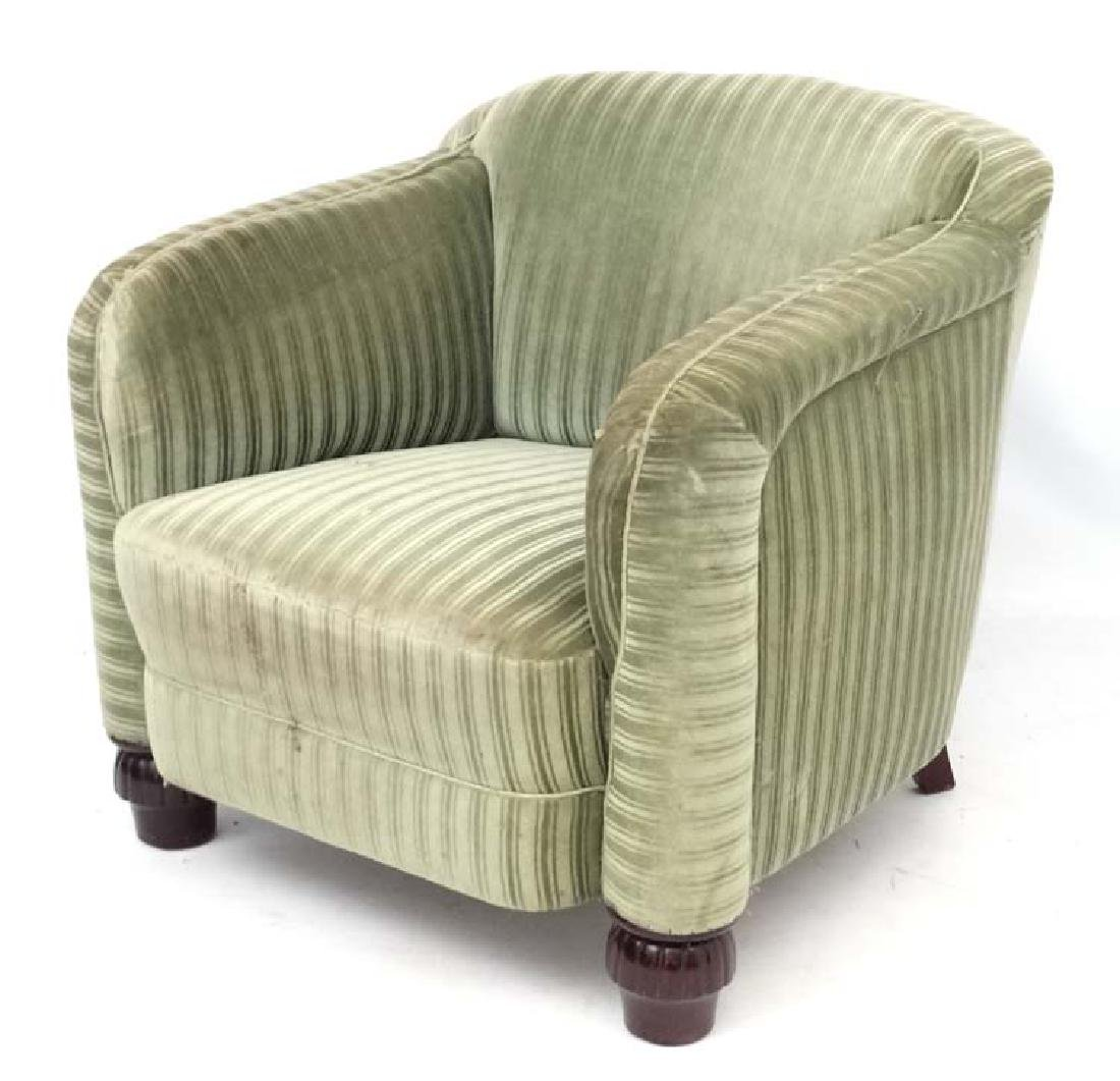 A Continental Art Deco green upholstered armchair on