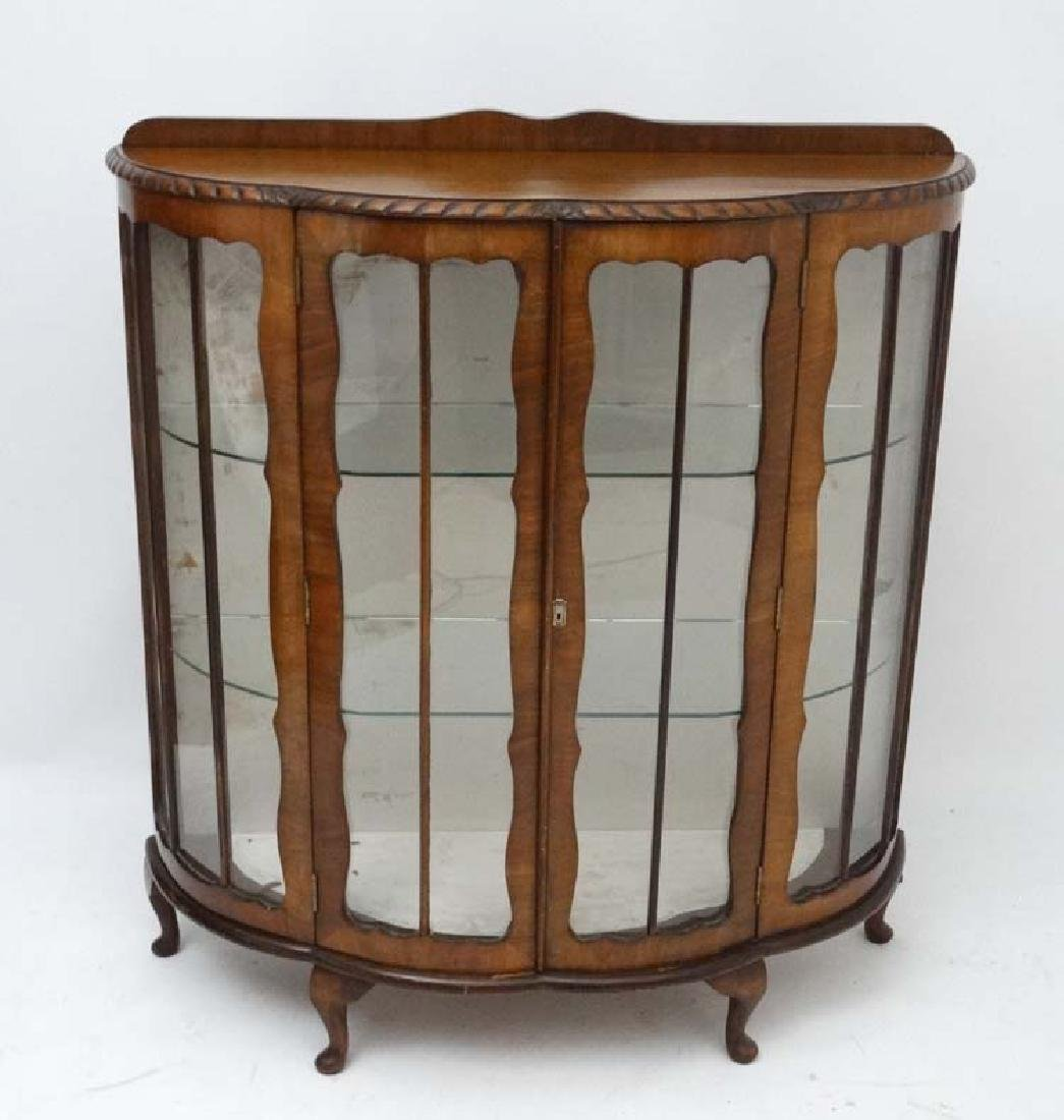 An early / mid 20thC walnut shaped bowfronted two door